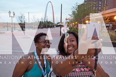 Renee Fernandes/NATA Iman Rollins, ATC, left and Tiffani Hall, ATC take a selfie with the view of the St. Louis Arch in the background on their way to the NATA Foundation Block Party.