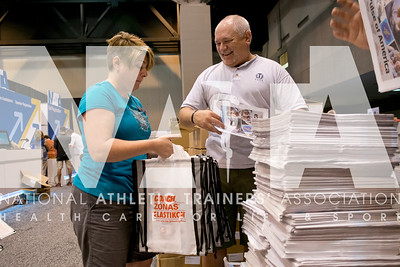 Renee Fernandes/NATA Cheryl Woodward, MBA, ATC, EMT and Brian Razak, ATC, fill bags as they volunteer their time in registration prior to the opening day of the meeting.