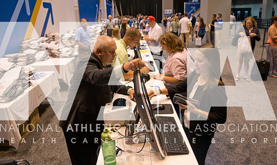 Renee Fernandes/NATA Brian Razak, ATC, LAT, left; helps members with their registration on Monday. About 8,000 people have registered for this year's convention.