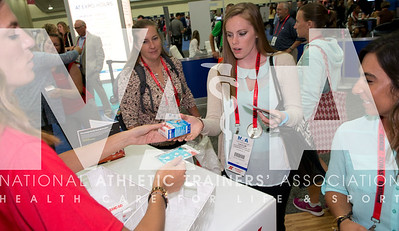 Renee Fernandes/NATA Caitlin Blackmore, ATC, picks up samples from the Johnson and Johnson booth.