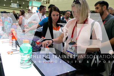 Renee Fernandes/NATA Jami Culbertson, ATC, VATL, learns about the prodeuct at the Gatorade booth.