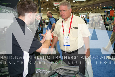 Renee Fernandes/NATA Christopher Pond, MS, ATC learns more from Sean Kupiec, of Recovery Pump during the AT Expo.