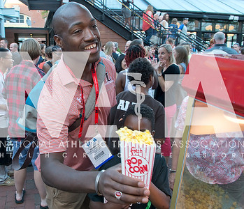 Renee Fernandes/NATA Moimusa Ahmadu, ATC, grabs some popcorn during the Welcome Reception Wednesday evening.