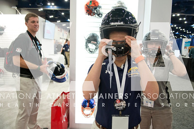 Renee Fernandes/NATA Hailey Katcher, MAT, ATC checks out the Riddell helmuts during the opening day of the Expo.