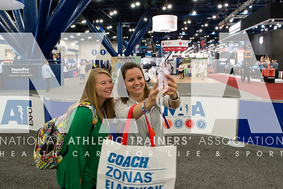 Renee Fernandes/NATA Laurie Thompson, ATC, left and Kimberly Wagner, ATC take a selfie before the opening of the AT Expo.