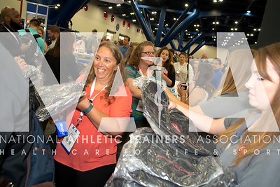 Renee Fernandes/NATA April Watson, MS, ATC, grabs a bag from the Cramer booth during the opening day of the Expo.