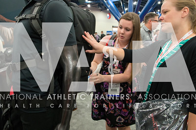 Renee Fernandes/NATA Ryhann Perry, LAT, ATC, left; and Jennifer Lancaster, PhD, ATC, LAT take a closer look at the bags in the Cramer booth during the opening day of the Expo.