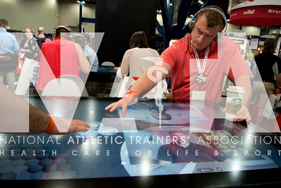 Renee Fernandes/NATA John Strasky, ATC, listens to information in the Gatorade booth during the opening day of the Expo.