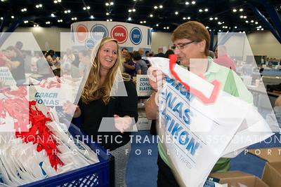 Renee Fernandes/NATA Melissa Hausman, MS, LAT, ATC, left and Cyndi Rains, ATC, LAT helps stuff bags before the meeting.