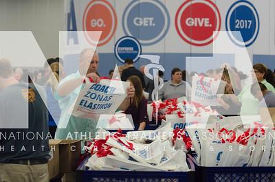 Renee Fernandes/NATA Brad Brown, MS, ATC, LAT, helps to stuff bags.