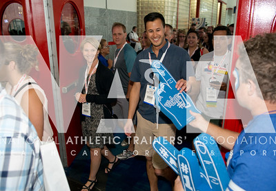 Renee Fernandes/NATA Danny Lowell, ATC, grabs a foam finger on his way into the Welcome Reception.