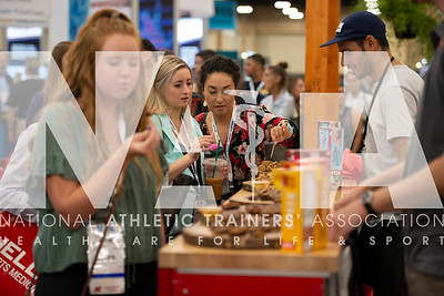 Renee Fernandes/NATA Ariana Fakeri, ATC, tries samples during the openind day of the trade show.