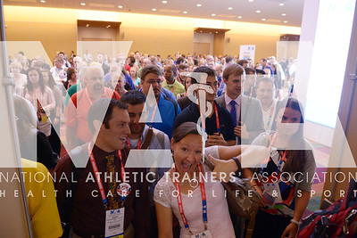 Renee Fernandes/NATA Thousands rush in during the opening day of the trade show at the annual meeting.
