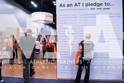 Renee Fernandes/NATA Anne Beethe, ATC, LAT, CSCS signs the wall at the Johnson and Johnson booth during the opening day of the trade show at the annual meeting.