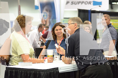 Renee Fernandes/NATA Pat Graman, ATC, left and Alys Staten, MS, ATC, talks with vendors during the opening day of the trade show.