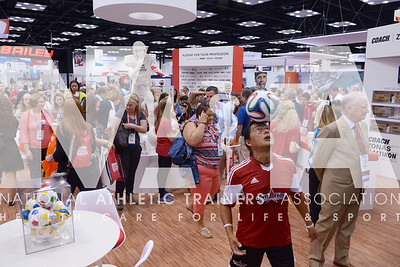 Renee Fernandes/NATA Professional soccer players were part of the Johnson and Johnson booth during the opening day of the trade show.
