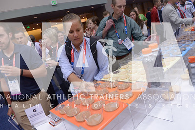 Renee Fernandes/NATA Lori Moss, MS, ATC, reaches for a taste of the product at the Gatorade booth during the opening day of the trade show at the annual meeting.