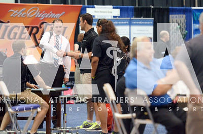 Renee Fernandes/NATA Casey Kohr, ATC, DPT, finishes a conversation with a vendor during the last day of the trade show.