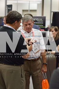 Renee Fernandes/NATA Johnny Long, LAT, gets details on product at the DJOGlobal booth during the opening day of trade show.