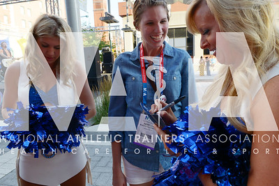 Renee Fernandes/NATA Rebecca Williams, ATC, gets and autograph from the cheerleaders during the welcome reception.