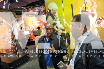 Renee Fernandes/NATA David Jackson, Oklahoma Secondary School Activities Association, left, talks with Robert ?? during the recpetion in the Hall of Champions at the NCAA headquarters.