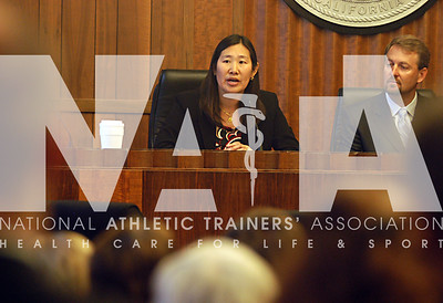 Dr. Cindy Chang, a team physician for UC Berkeley, talks to the group during the youth sports safety summit in Sacramento. photo by Renee Fernandes