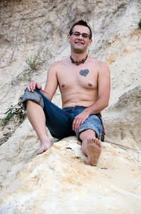 NATE SITTING ON A ROCK
