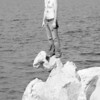 NATE STANDING ON ROCKS B&W