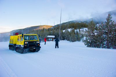 Snow coaches in Yellowstone carry luggage to Old faith for hotel guests.
