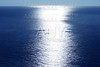 Blue sky horizon bird view with sun reflexion white line