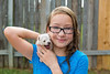 kid girl with puppy pet chihuahua playing happy