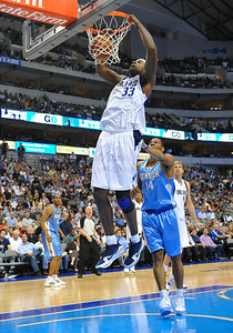 March 29th, 2010   Dallas Mavericks center Brendan Haywood #33 gets a dunk over Denver Nuggets guard Joey Graham #14 in a game between the Denver Nuggets and the Dallas Mavericks at the American Airlines Center in Dallas, Texas. Dallas wins 109-93