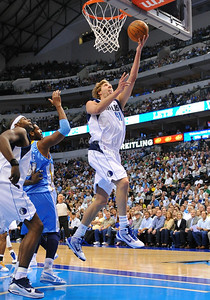 March 29th, 2010   Dallas Mavericks forward Dirk Nowitzki #41 drives to the basket in a game between the Denver Nuggets and the Dallas Mavericks at the American Airlines Center in Dallas, Texas. Dallas wins 109-93