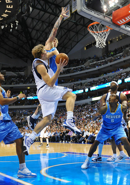 March 29th, 2010  <br /> Dallas Mavericks forward Dirk Nowitzki #41 drives to the basket and gets fouled by Denver Nuggets center Chris Andersen #11<br /> in a game between the Denver Nuggets and the Dallas Mavericks at the American Airlines Center in Dallas, Texas.<br /> Dallas wins 109-93