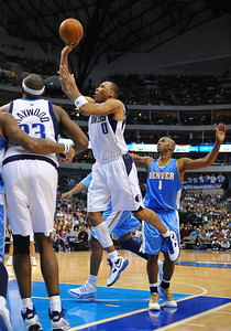 March 29th, 2010   Dallas Mavericks forward Shawn Marion #0 drives to the basket in a game between the Denver Nuggets and the Dallas Mavericks at the American Airlines Center in Dallas, Texas. Dallas wins 109-93