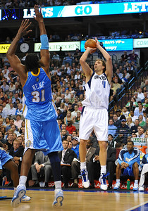 March 29th, 2010   Dallas Mavericks forward Dirk Nowitzki #41 shoots the ball in a game between the Denver Nuggets and the Dallas Mavericks at the American Airlines Center in Dallas, Texas. Dallas wins 109-93