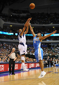 March 29th, 2010   Dallas Mavericks forward Caron Butler #4 shoots over Denver Nuggets guard Arron Afflalo #6 in a game between the Denver Nuggets and the Dallas Mavericks at the American Airlines Center in Dallas, Texas. Dallas wins 109-93