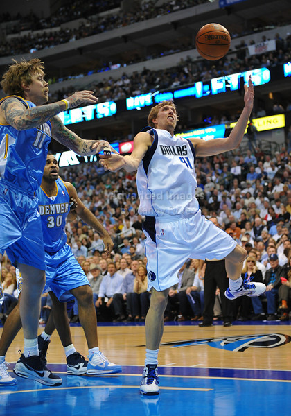 March 29th, 2010  <br /> Dallas Mavericks forward Dirk Nowitzki #41 and Denver Nuggets center Chris Andersen #11 go for a loose ball<br /> in a game between the Denver Nuggets and the Dallas Mavericks at the American Airlines Center in Dallas, Texas.<br /> Dallas wins 109-93