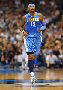March 29th, 2010   Denver Nuggets forward Carmelo Anthony #15 struggles at shooting the ball in a game between the Denver Nuggets and the Dallas Mavericks at the American Airlines Center in Dallas, Texas. Dallas wins 109-93