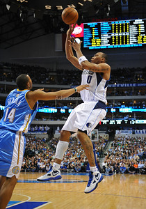 March 29th, 2010   Dallas Mavericks forward Shawn Marion #0 drives and shoots the ball in a game between the Denver Nuggets and the Dallas Mavericks at the American Airlines Center in Dallas, Texas. Dallas wins 109-93