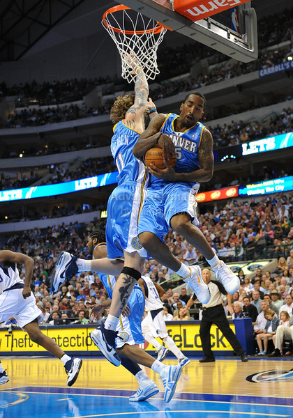 March 29th, 2010  <br /> Denver Nuggets guard J.R. Smith #5 gets a rebound<br /> in a game between the Denver Nuggets and the Dallas Mavericks at the American Airlines Center in Dallas, Texas.<br /> Dallas wins 109-93