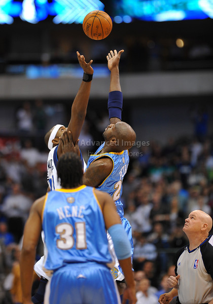 March 29th, 2010  <br /> Dallas Mavericks center Brendan Haywood #33 and Denver Nuggets center Johan Petro #27 go after a jump ball as Ref Joey Crawford looks on in a game between the Denver Nuggets and the Dallas Mavericks at the American Airlines Center in Dallas, Texas.<br /> Dallas wins 109-93