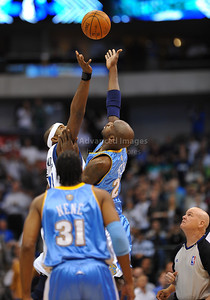 March 29th, 2010   Dallas Mavericks center Brendan Haywood #33 and Denver Nuggets center Johan Petro #27 go after a jump ball as Ref Joey Crawford looks on in a game between the Denver Nuggets and the Dallas Mavericks at the American Airlines Center in Dallas, Texas. Dallas wins 109-93