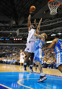 March 29th, 2010   Dallas Mavericks center Brendan Haywood #33 shoots over Denver Nuggets center Chris Andersen #11in a game between the Denver Nuggets and the Dallas Mavericks at the American Airlines Center in Dallas, Texas. Dallas wins 109-93