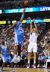 March 29th, 2010   Dallas Mavericks forward Dirk Nowitzki #41 shoots the ball over Denver Nuggets center Nene Hilario #31 in a game between the Denver Nuggets and the Dallas Mavericks at the American Airlines Center in Dallas, Texas. Dallas wins 109-93