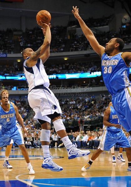 March 29th, 2010  <br /> Dallas Mavericks forward Caron Butler #4 stops and shoots the ball as Denver Nuggets forward Malik Allen #30 defends in a game between the Denver Nuggets and the Dallas Mavericks at the American Airlines Center in Dallas, Texas.<br /> Dallas wins 109-93