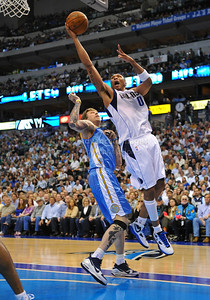 "March 29th, 2010   Dallas Mavericks forward Shawn Marion #0 drives to the basket against Denver Nuggets center Chris ""The Birdman"" Andersen #11 in a game between the Denver Nuggets and the Dallas Mavericks at the American Airlines Center in Dallas, Texas. Dallas wins 109-93"