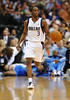 March 29th, 2010  <br /> Dallas Mavericks guard Rodrigue Beaubois #3 brings the ball forward<br /> in a game between the Denver Nuggets and the Dallas Mavericks at the American Airlines Center in Dallas, Texas.<br /> Dallas wins 109-93
