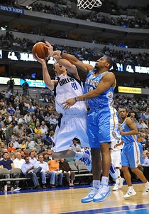 March 29th, 2010   Dallas Mavericks forward Dirk Nowitzki #41 shoots the ball and gets fouled by Denver Nuggets guard Joey Graham #14 in a game between the Denver Nuggets and the Dallas Mavericks at the American Airlines Center in Dallas, Texas. Dallas wins 109-93