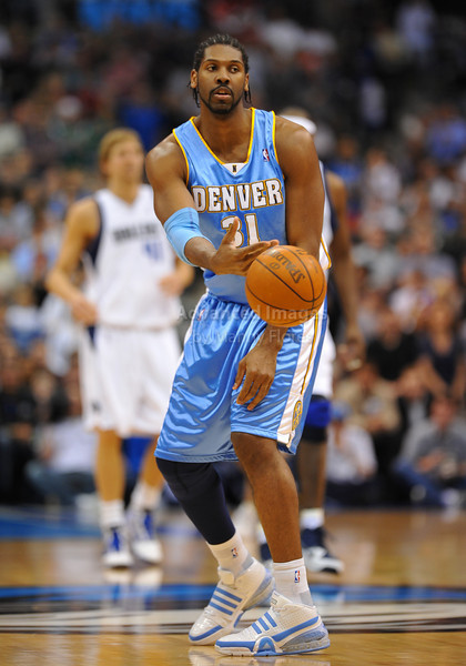 March 29th, 2010  <br /> Denver Nuggets center Nene Hilario #31 passes the ball<br /> in a game between the Denver Nuggets and the Dallas Mavericks at the American Airlines Center in Dallas, Texas.<br /> Dallas wins 109-93